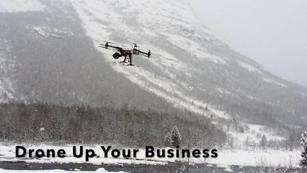 Photo of drone flying in the mountains indicating the use of commercial drones (UAVs, UAS, or quadcopters)
